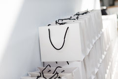 Shopping bags. White shopping bags beside the wall stock photo