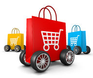Shopping Bags With Cart Symbol And Wheels Stock Photo