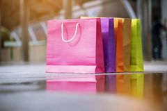 Shopping bags of women crazy shopaholic person at shopping mall indoor. Fashionable Woman love online website with sales tag on. Black friday. E-commerce stock photography