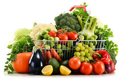 Shopping basket with assorted raw organic vegetables over white Royalty Free Stock Photo