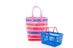 A shopping basket and a bag Royalty Free Stock Photography