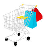 Shopping basket and bags Royalty Free Stock Image