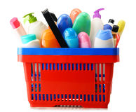 Shopping basket with body care and beauty products over white Stock Image