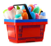 Shopping basket with body care and beauty products over white Royalty Free Stock Photo