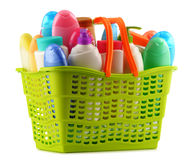 Shopping basket with body care and beauty products over white Royalty Free Stock Images