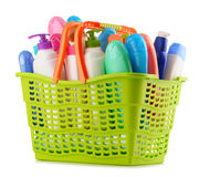 Shopping basket with body care and beauty products over white Stock Photo