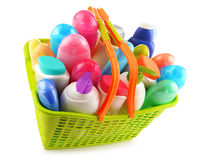 Shopping basket with body care and beauty products over white Royalty Free Stock Photos