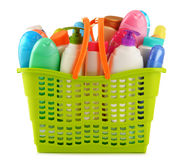 Shopping basket with body care and beauty products over white Stock Images