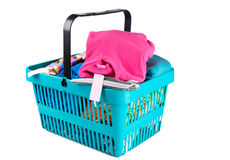 Shopping basket with clothes Stock Images