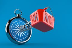 Shopping basket with compass. Isolated on blue background. 3d illustration Stock Photos