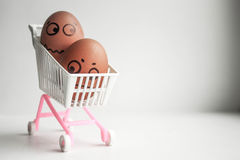 Shopping basket concept. Funny egg. With a sketched face. Photo for your design Royalty Free Stock Image