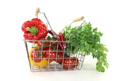 Shopping basket with crisp vegetables Royalty Free Stock Photography