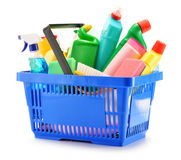 Shopping basket with detergent bottles isolated on white royalty free stock photo