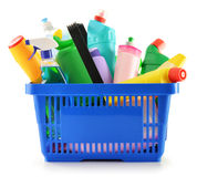 Shopping basket with detergent bottles isolated on white stock photography