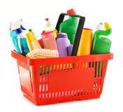 Shopping basket with detergent bottles on white Stock Image