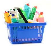 Shopping basket with detergent bottles on white Royalty Free Stock Photography