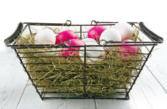Shopping basket with easter eggs Stock Images