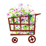 Shopping basket with flowers Royalty Free Stock Photo