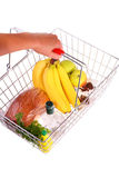 Shopping Basket of Food. Supermarket Basket filled with food. White background Stock Photography