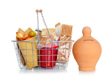 The shopping basket with food and money box Royalty Free Stock Images