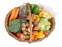 Shopping basket with foods fruits and vegetables Royalty Free Stock Images
