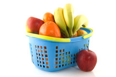 Shopping basket with fresh fruit Stock Images