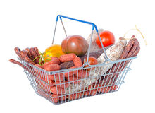 Shopping basket full of food including fresh of tasty delicious. Dried and boiled sausages, tomatoes is isolated on white background Stock Image