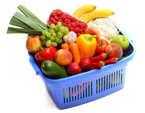 A shopping basket full of fresh produce. On white Royalty Free Stock Photography