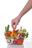 Shopping basket full of fresh vegetables Stock Photography