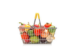 Shopping basket full of fruit and vegetables Royalty Free Stock Photos