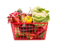 Shopping basket full groceries Stock Photos