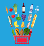 Shopping basket full of groceries products. Red plastic shopping basket full of groceries products. Grocery store. Fresh organic food and drinks. Vector Royalty Free Stock Image