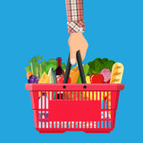 Shopping basket full of groceries products. Red plastic shopping basket full of groceries products in hand. Grocery store. illustration in flat style Stock Photo