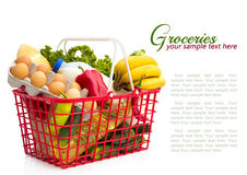 Shopping basket with groceries. , isolated over white background Royalty Free Stock Photos