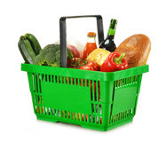 Shopping basket and groceries isolated on white Royalty Free Stock Photo