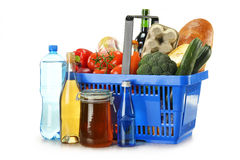 Shopping basket and groceries isolated on white Stock Image