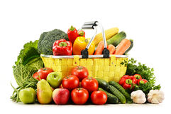 Shopping basket with groceries on white Royalty Free Stock Photography