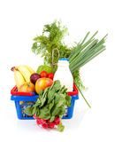 Shopping basket with grocery. Shopping basket filled with healthy grocery over white background Royalty Free Stock Images