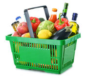 Shopping basket with grocery isolated on white Royalty Free Stock Photo