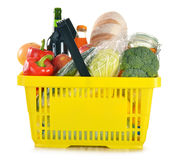 Shopping basket with grocery products Stock Image