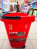 Shopping basket with grocery at supermarket Stock Photos