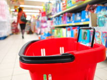 Shopping basket with grocery at supermarket Royalty Free Stock Photo