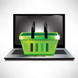 Shopping basket and laptop Royalty Free Stock Images