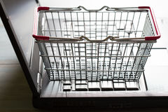 Shopping basket on laptop buying online abstract background concept Royalty Free Stock Image