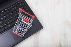 Shopping basket on a laptop. Stock Image