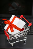 Shopping basket on a laptop. Stock Photography