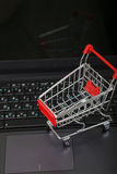 Shopping basket on a laptop. Royalty Free Stock Photos
