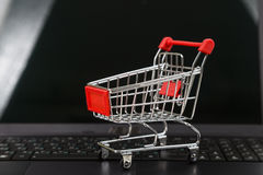 Shopping basket on a laptop. Royalty Free Stock Image