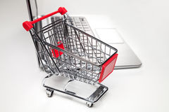 Shopping basket and laptop Stock Image