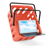 Shopping basket and laptop Stock Photography